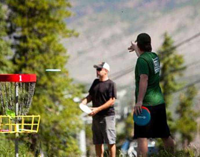 Men playing frisbee in Snowmass